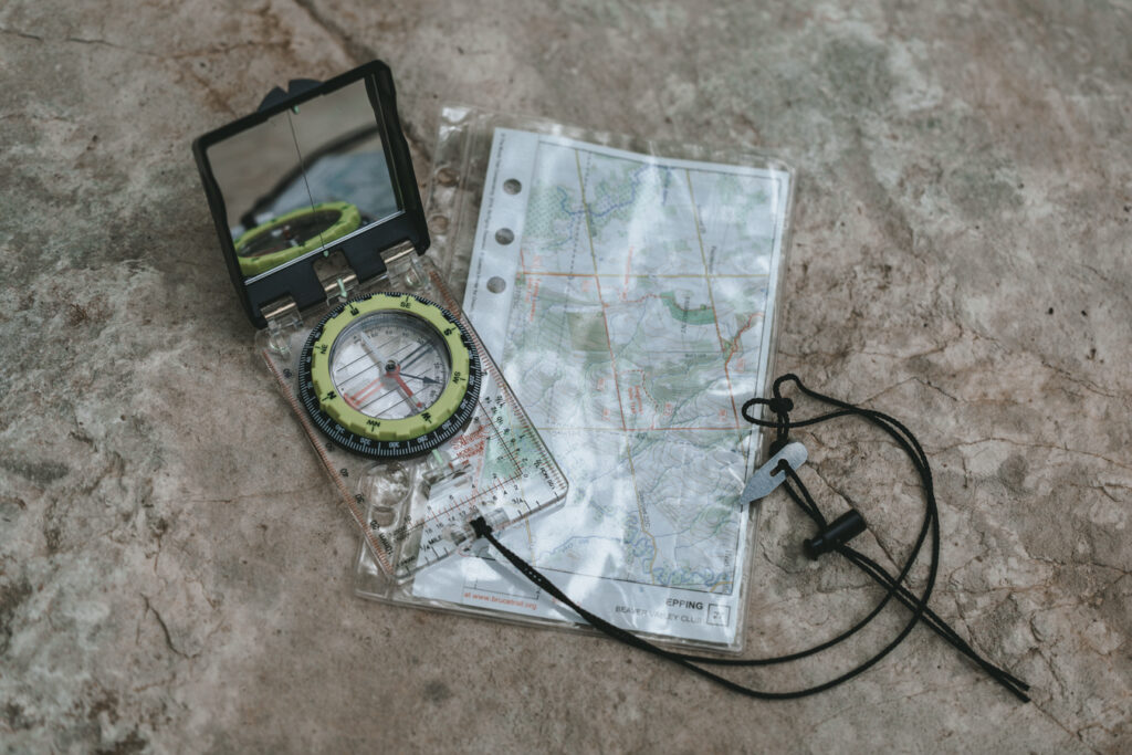 compass and a map   Day hiking Essentials: What's in my day pack?   My Wandering Voyage travel blog #DayHike #Hiking #HikingEssentials #HikingChecklist