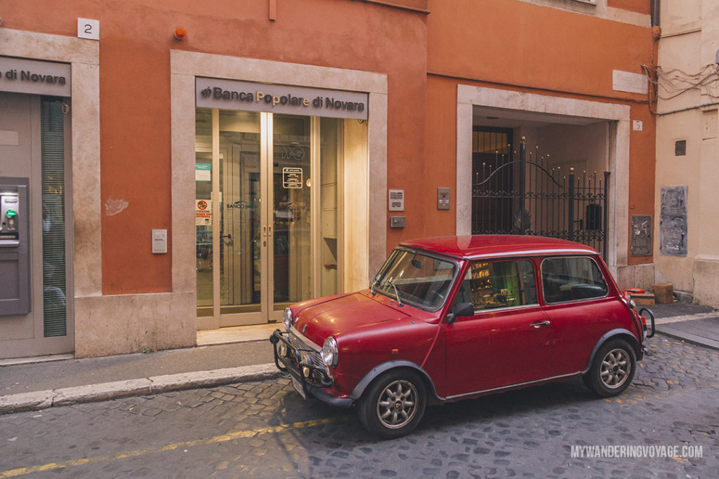 little red car on Rome street | With these 23 mistakes to avoid in Rome, Italy, you'll be a seasoned traveller before you even land in the airport. | My Wandering Voyage travel blog #Rome #traveltips #travel #Italy