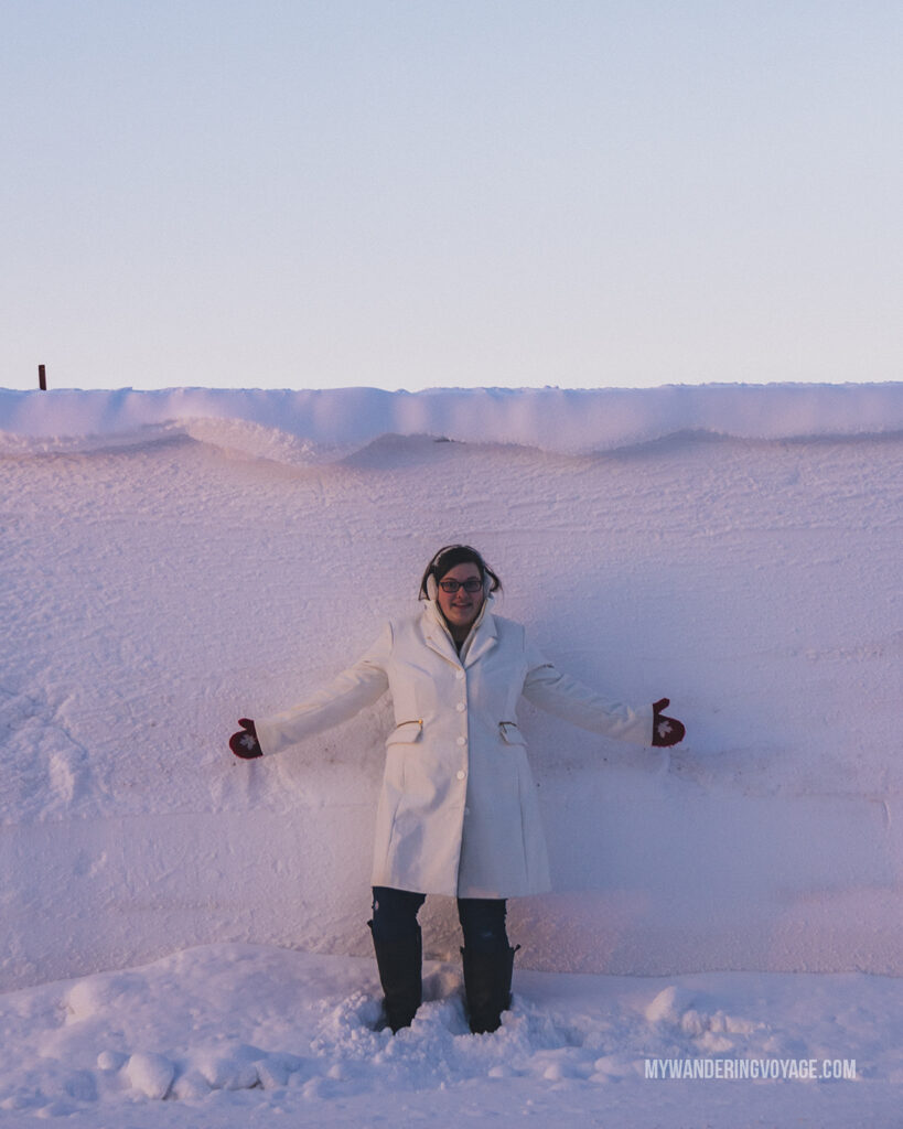winter in Ontario, person standing in front of seven foot snow bank
