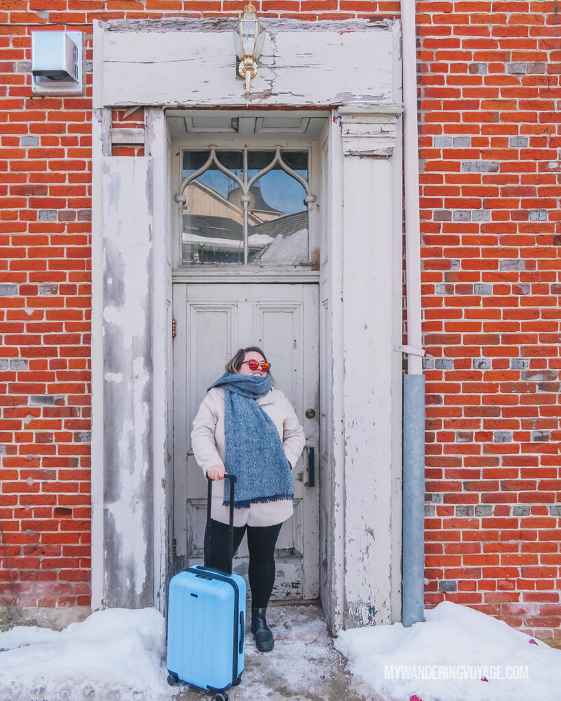 Woman with CHESTER suitcase | CHESTER luggage review for best carry on luggage | My Wandering Voyage Travel Blog
