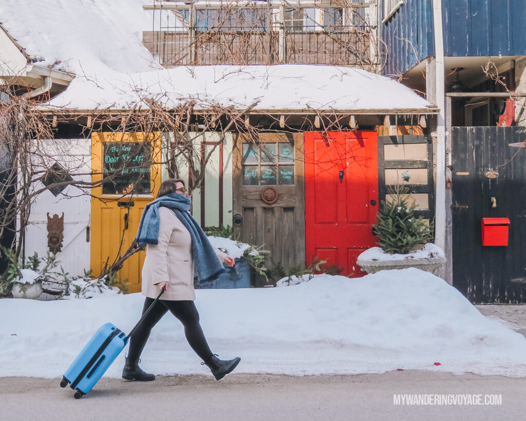 woman walking with CHESTER luggage outside in winter | CHESTER luggage review for best carry on luggage | My Wandering Voyage Travel Blog