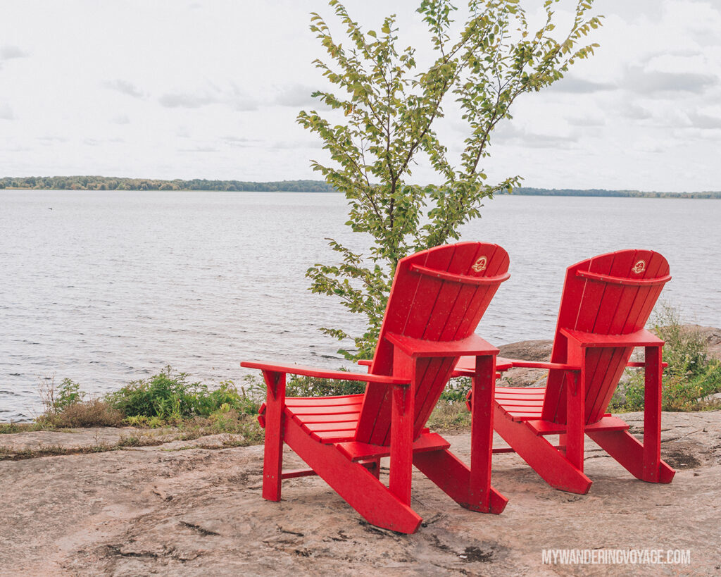 red chairs at Thousand Islands National Park | The Ultimate Guide to National Parks in Ontario | My Wandering Voyage travel blog #travel #Ontario #Canada #BrucePeninsula #ThousandIslands #camping